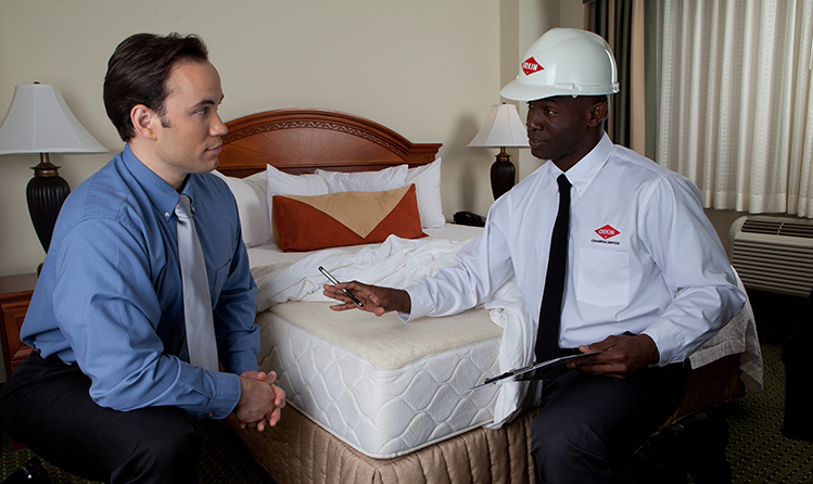 hospitality hotel pest control inspection with customer